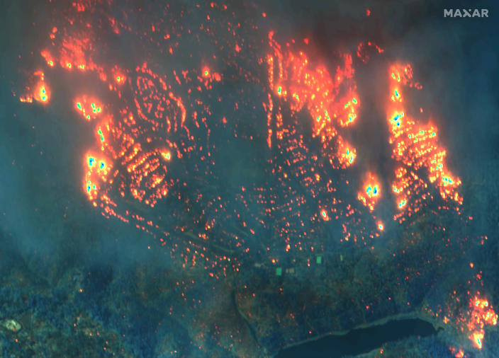 This Nov. 9, 2018, image provided by Maxar Technologies shows fires in Paradise, Calif. (Satellite image ©2019 Maxar Technologies via AP)