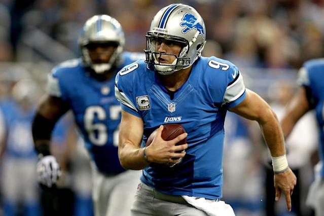 DETROIT, MI - NOVEMBER 18: Quarterback Matthew Stafford #12 of the Detroit is chased out of the pocket against the Green Bay Packers at Ford Field on November 18, 2012 in Detroit, Michigan. (Photo by Matthew Stockman/Getty Images)