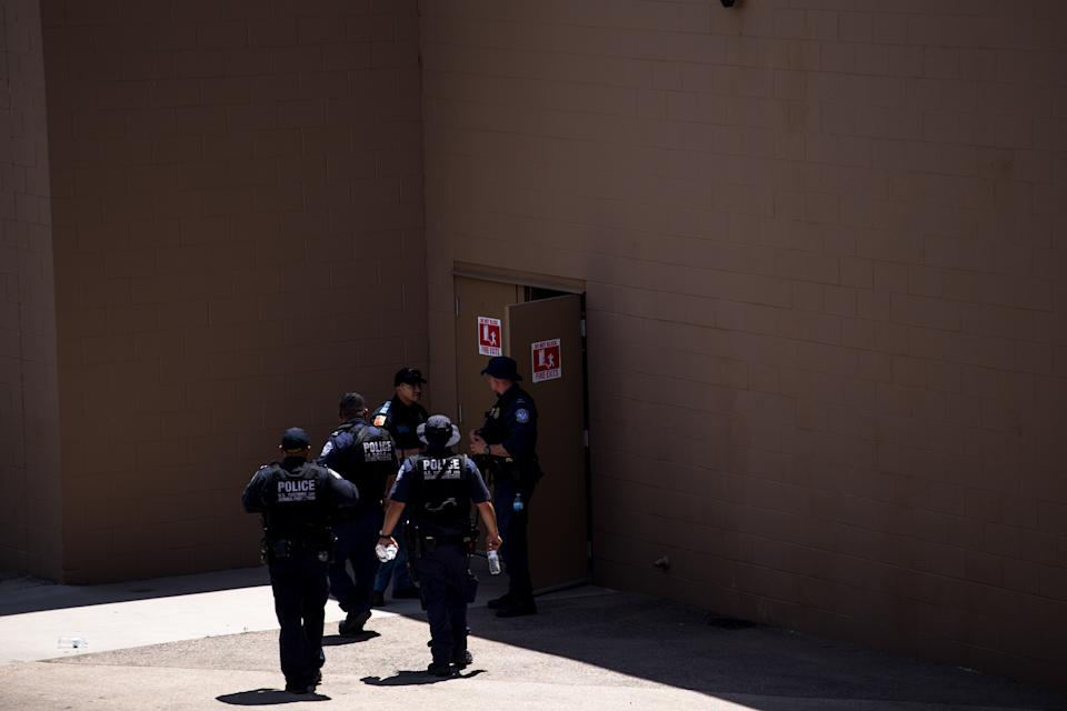 Law enforcement agencies cover the exits of a Wal-Mart where a shooting occurred near Cielo Vista Mall in El Paso, Texas, on August 3, 2019.  (Photo: Joel Angel Juarez/AFP/Getty Images)