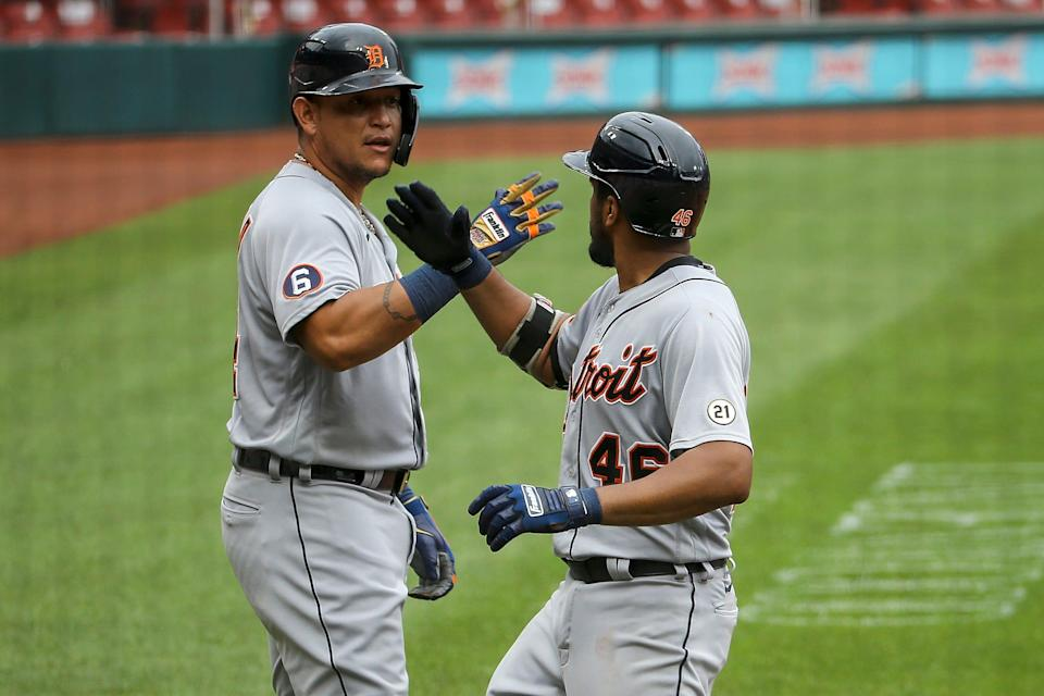 Tigers designated hitter Miguel Cabrera, left, congratulates first baseman Jeimer Candelario after Candelario hit a two-run home run during the fourth inning of the Tigers' 12-2 loss in the first game of a doubleheader on Thursday, Sept. 10, 2020, in St. Louis.