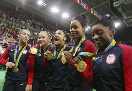 2016 Rio Olympics - Artistic Gymnastics - Final - Women's Team Final - Rio Olympic Arena - Rio de Janeiro, Brazil - 09/08/2016. (L-R) Alexandra Raisman (USA) of USA (Aly Raisman), Madison Kocian (USA) of USA, Laurie Hernandez (USA) of USA, Gabrielle Douglas (USA) of USA (Gabby Douglas) and Simone Biles (USA) of USA with their gold medals after winning the women's team final. REUTERS/Mike Blake