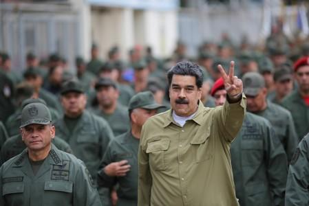 FILE PHOTO: Venezuela's President Nicolas Maduro gestures during a meeting with soldiers at a military base in Caracas