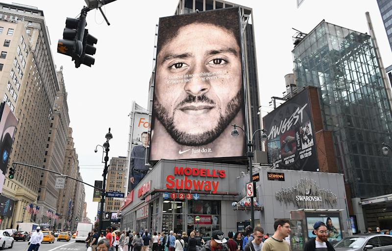(FILES) In this file photo taken on September 8, 2018 a Nike Ad featuring American football quarterback Colin Kaepernick is on diplay in New York City. - American millennials -- the generation of people aged 17-35 -- are a popular target for advertisers and brands, but companies risk missing out by approaching them as one homogeneous population. From Gillette razors to McDonald's and American Express, every major American company is touting its efforts to attract these young people, considered the workforce of tomorrow and the new generation of consumers. (Photo by Angela Weiss / AFP) (Photo credit should read ANGELA WEISS/AFP/Getty Images)