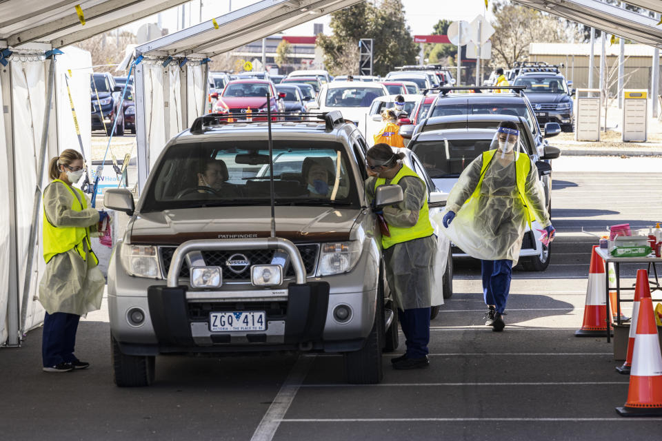 People queue in their cars for a COVID test at a drive-through testing site at Shepparton Sports Precinct in Shepparton, Victoria on Tuesday. Source: AAP