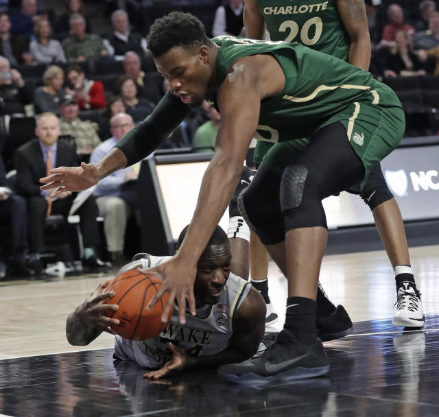 Wake Forest's Sunday Okeke, bottom, looks to pass the ball as Charlotte's Jailan Haslem, top, defends in the first half of an NCAA college basketball game in Winston-Salem, N.C., Thursday, Dec. 6, 2018. (AP Photo/Chuck Burton)
