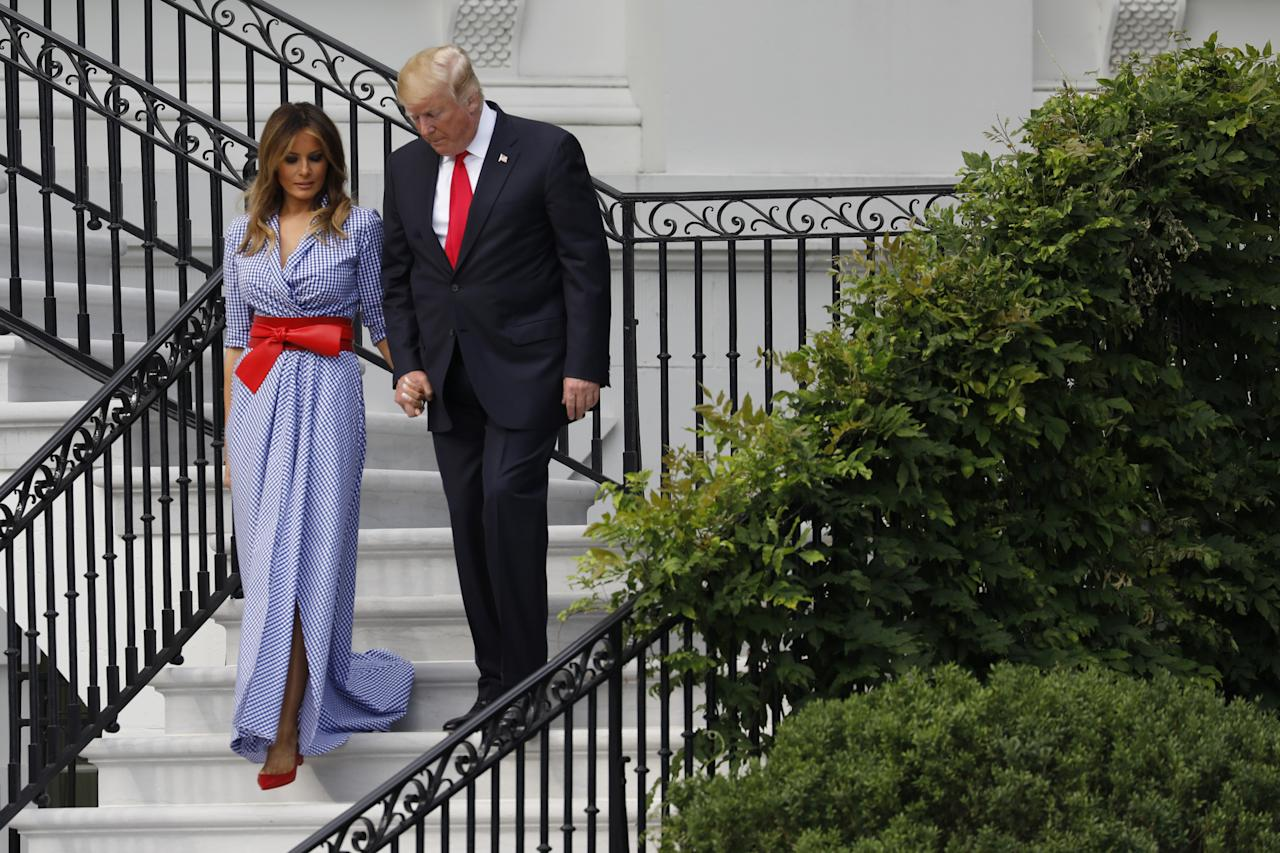 <p>Melania Trump's outfit for the annual White House Fourth of July picnic was as American as it gets. The first lady, who joined President Trump in hosting military families for fireworks and food, wore a floor-length dress by Ralph Lauren costing $3,770. She decorated the look in patriotic red by addition of a red belt at the waist. Photo: Getty </p>