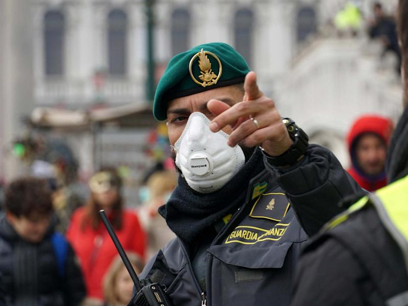 A police officer wears a face mask during the Venice Carnival in Italy: EPA