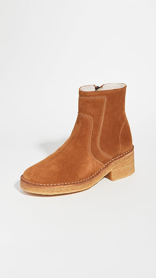 """<p>These <product href=""""https://www.shopbop.com/ariette-boots-apc/vp/v=1/1588874477.htm?folderID=13468&amp;fm=other-shopbysize-viewall&amp;os=false&amp;colorId=194B7&amp;ref_=SB_PLP_NB_4"""" target=""""_blank"""" class=""""ga-track"""" data-ga-category=""""internal click"""" data-ga-label=""""https://www.shopbop.com/ariette-boots-apc/vp/v=1/1588874477.htm?folderID=13468&amp;fm=other-shopbysize-viewall&amp;os=false&amp;colorId=194B7&amp;ref_=SB_PLP_NB_4"""" data-ga-action=""""body text link"""">A.P.C. Ariette Boots</product> ($415) are lined with shearling, so they're super cozy.</p>"""