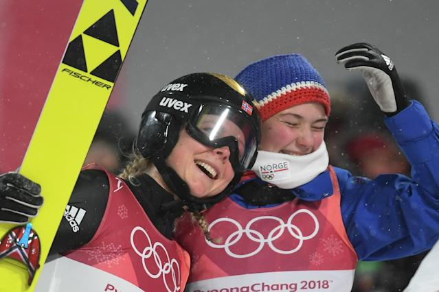 <p>Gold medallist Norway's Maren Lund (L) is joined by Norway's Silje Opseth as they celebrate Norway's win following the women's normal hill individual ski jumping event during the Pyeongchang 2018 Winter Olympic Games on February 12, 2018, in Pyeongchang. / AFP PHOTO / Christof STACHE </p>