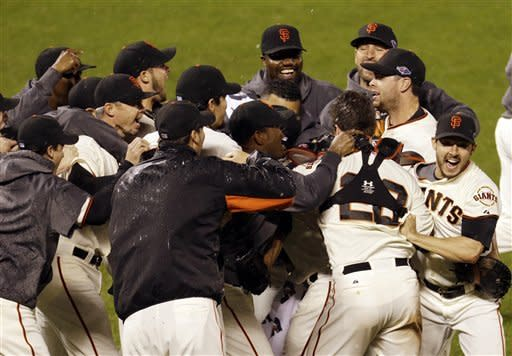 The San Francisco Giants celebrate after the final out in Game 7 of baseball's National League championship series against the St. Louis Cardinals Monday, Oct. 22, 2012, in San Francisco. The Giants won 9-0 to win the series. (AP Photo/Eric Risberg)