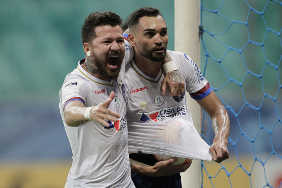 Brazil's Bahia Gilberto (R) celebrates with teammate Rossi after scoring against Argentina's Union during their closed-door Copa Sudamericana round before the quarterfinals football match at the Arena Fonte Nova stadium in Salvador, Brazil, on November 24, 2020. (Photo by Arisson MARINHO / AFP) (Photo by ARISSON MARINHO/AFP via Getty Images)