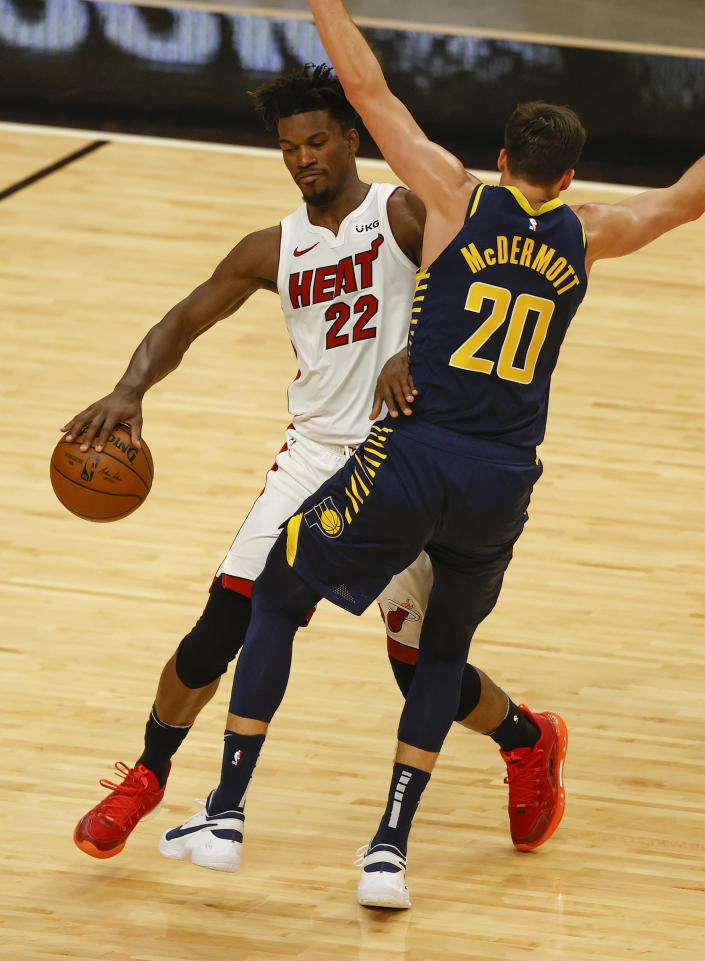 Miami Heat forward Jimmy Butler (22) is fouled by Indiana Pacers forward Doug McDermott (20) during the second half of an NBA basketball game, Sunday, March. 21, 2021, in Miami. (AP Photo/Joel Auerbach)