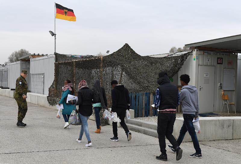 Migrants walk to a registration point for asylum seekers in Erding, Germany in November 2016 (AFP Photo/CHRISTOF STACHE)