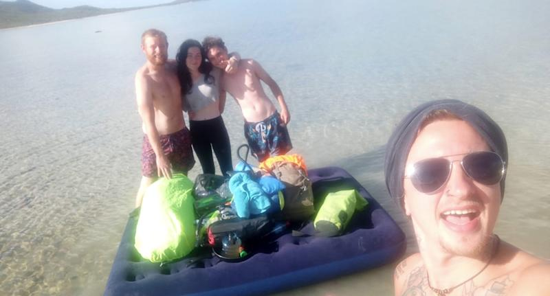 The friends with the air mattress which they used on their journey to Gloucester Island near Airlie Beach