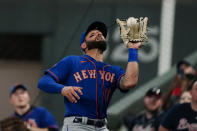 New York Mets right fielder Kevin Pillar (11) catches a ball in foul territory to retire Atlanta Braves' Ronald Acuna Jr. in the sixth inning of a baseball game Monday, May 17, 2021, in Atlanta. (AP Photo/John Bazemore)