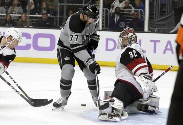 Arizona Coyotes goaltender Antti Raanta, right, of Finland, blocks a shot by Los Angeles Kings center Jeff Carter (77) during the second period of an NHL hockey game in Los Angeles, Saturday, Nov. 23, 2019. (AP Photo/Alex Gallardo)