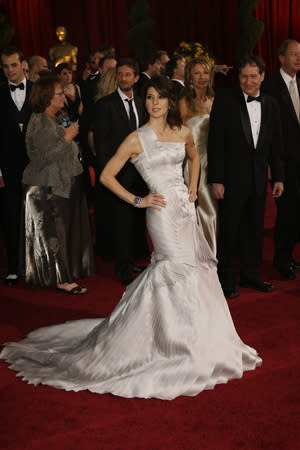 "<div class=""caption-credit""> Photo by: Fairchild Archive</div><div class=""caption-title""></div><p>   <b>Marisa Tomei's white Versace dress, 2009</b> </p> <p>   Here's proof that you can avoid the dreaded ""fussy"" judgment while sporting more pleats than a JV cheering squad. Marisa Tomei arrived at the Academy Awards in a formfitting one-shouldered origami-inspired gown with a small train and still managed to look elegant and effortless. </p>"