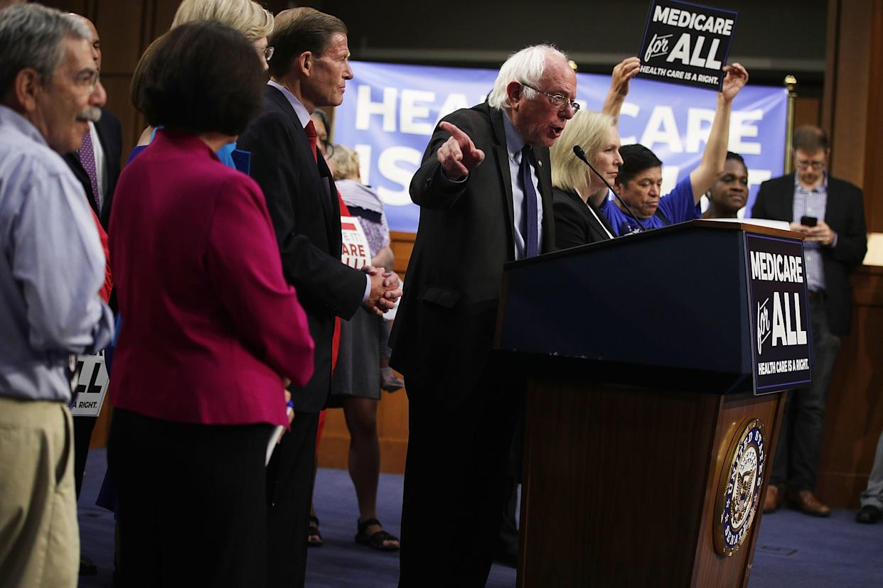 Sen. Bernie Sanders (I-Vt.), center, speaks on health care as Sen. Richard Blumenthal (D-Conn.), left, and Sen. Kirsten Gillibrand (D-N.Y.), right, listen during an event to introduce the Medicare for All Act on Sept. 13, 2017.