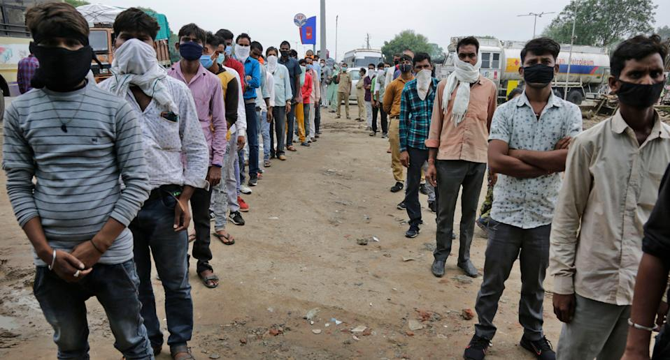 COVID-19 testing at a check post erected to screen people coming from outside the city in Ahmedabad, India. Source: AP