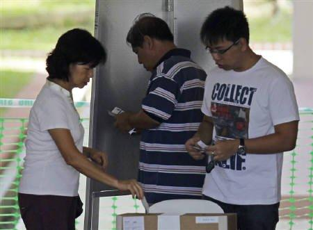 Singaporeans casting their votes on 7 May 2011. (Reuters)