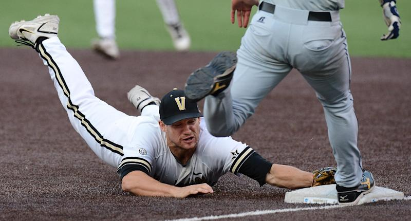 Vanderbilt first baseman Conrad Gregor (55) dives to first, touching the bag for the out, after fielding a Georgia Tech grounder in the fifth inning of an NCAA college baseball tournament regional game Monday, June 3, 2013, in Nashville, Tenn. (AP Photo/Mark Zaleski)