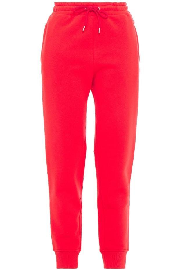 "<p>Paco Rabanne Cotton-Fleece Track Pants, $189 (from $344), <a href=""https://rstyle.me/+CrflH6Rvfc5p5kfGs5ROdg"" rel=""nofollow noopener"" target=""_blank"" data-ylk=""slk:available here"" class=""link rapid-noclick-resp"">available here</a>. </p>"