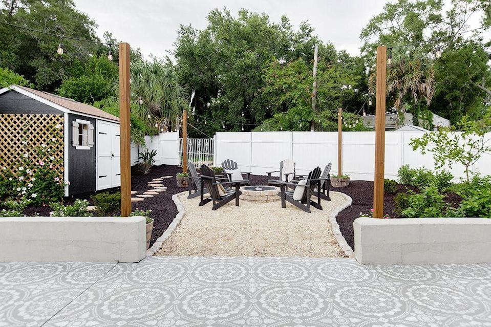 """<p>""""Make sure there's proper irrigation in place to keep your landscaping alive, and really consider how you want to use the space in the years to come,"""" Sue tells future DIY-ers. """"Backyard renovations are much more involved (and usually more permanent) than interior renovations, so it pays to plan ahead.""""</p><p><strong>Suggested Products</strong>: <a href=""""https://www.lowes.com/pd/Shine-Company-Westport-Wood-Stationary-Adirondack-Chair-s-with-Slat-Seat/1000720442?cm_mmc=inf-_-c-_-prd-_-sol-_-ldy-_jens-_-blg-_-qtw-_-how-_-bac070120"""" rel=""""nofollow noopener"""" target=""""_blank"""" data-ylk=""""slk:Adirondack chairs"""" class=""""link rapid-noclick-resp"""">Adirondack chairs</a> ($87, Lowes); <a href=""""https://www.lowes.com/pd/Firepit-Kit-43-5-in-W-x-43-5-in-L-Ashland-Concrete-Fire-Pit-Kit/4686367"""" rel=""""nofollow noopener"""" target=""""_blank"""" data-ylk=""""slk:fire pit"""" class=""""link rapid-noclick-resp"""">fire pit</a> ($219, Lowes); <a href=""""https://www.lowes.com/pd/Portfolio-24-ft-12-Light-Plug-In-Bulbs-String-Lights/1000168071?cm_mmc=inf-_-c-_-prd-_-sol-_-ldy-_jens-_-blg-_-qtw-_-how-_-bac070120"""" rel=""""nofollow noopener"""" target=""""_blank"""" data-ylk=""""slk:string lights"""" class=""""link rapid-noclick-resp"""">string lights</a> ($40, Lowes)</p>"""