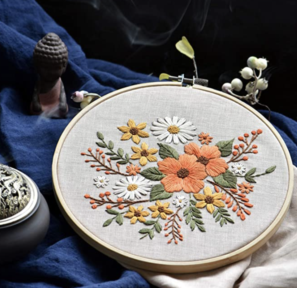PHOTO: Amazon. Embroidery Starter Kit with Pattern and Instructions Cross Stitch Kit, Plastic Embroidery Hoops, Color Threads Needle Kit (4 Pcs Floral)