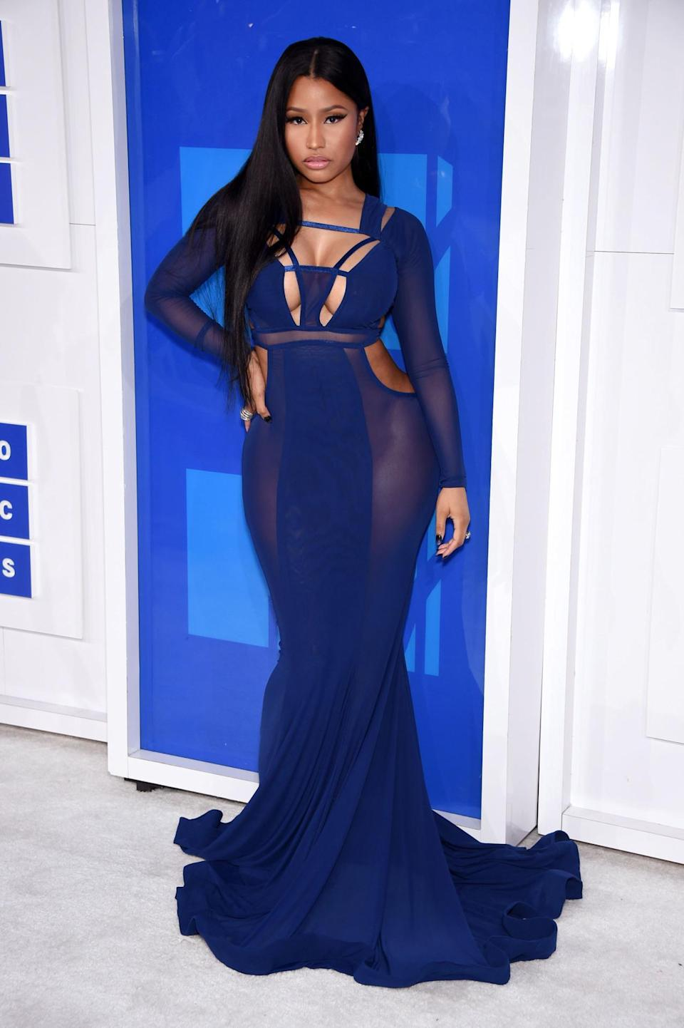 <p>Nicki Minaj's curve-hugging gown featured every element a sexy dress requires: cutouts, sheer, and superclingy material. <i>(Photo: Getty Images)</i></p>