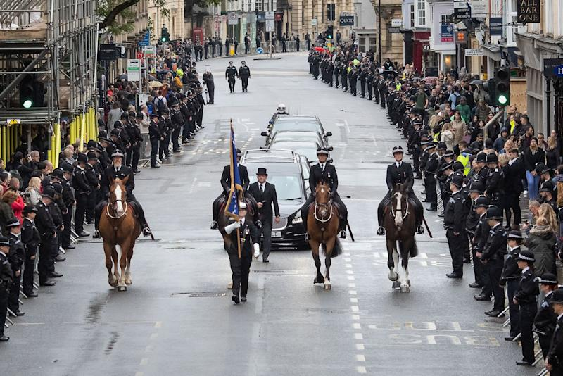 People line the High Street in Oxford to pay their respects as the funeral cortege for Pc Andrew Harper: PA