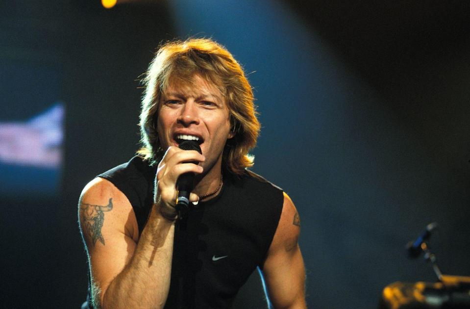 <p>Jon Bon Jovi said farewell to his feathered bangs and curly hair in the early '90s, but the rockstar continued to slay on stage with shoulder length, sandy blonde hair. </p>