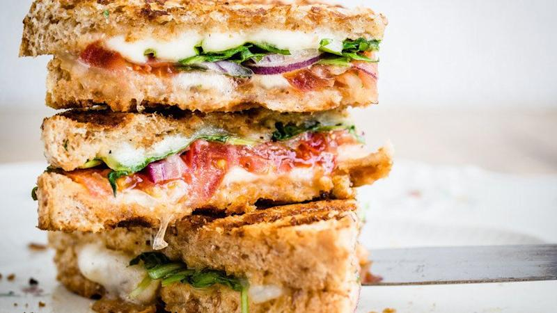 """A sandwich made with... <br /><br />- <a href=""""http://www.pepperidgefarm.com/ProductDetail.aspx?catID=750&amp;prdID=120269"""" target=""""_blank"""">Two slices of whole wheat bread</a>: 6 grams <br /> - Two ounces of <a href=""""http://boarshead.com/products/ham/101-branded-deluxe-ham-shattuck"""" target=""""_blank"""">deli ham</a> or <a href=""""http://boarshead.com/products/turkey/958-honey-smoked-turkey-breast-skinless"""" target=""""_blank"""">honey smoked turkey</a>: 2 grams <br />Lunch total: 8 grams <br /><br />Even whole wheat bread can contain more sugar than you think, so be sure to read the nutrition facts before you put a loaf in your cart. As for the sandwich meat, anything honey smoked or honey roasted is best avoided&mdash;choose non-sweet roasted varieties instead to save at least a gram or two of sugar. If plain oven roasted ham or turkey doesn&rsquo;t do it for you, try varieties packed with herbs and spices (like <a href=""""http://boarshead.com/products/ham/173-rosemary-sundried-tomato-ham"""" target=""""_blank"""">rosemary ham</a> or <a href=""""http://boarshead.com/products/turkey/276-cracked-pepper-mill-smoked-turkey-breast"""" target=""""_blank"""">cracked pepper turkey</a>) for flavor with less sugar."""