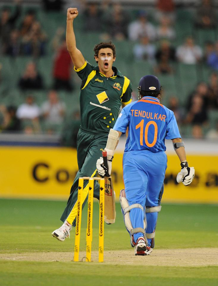Australia's Mitchell Starc celebrates the wicket of India's Sachin Tendulkar, right, after he was caught by Ricky Ponting during their one day international cricket match at the MCG in Melbourne. Australia, Sunday, Feb. 5, 2012. (AP Photo/Mal Fairclough)