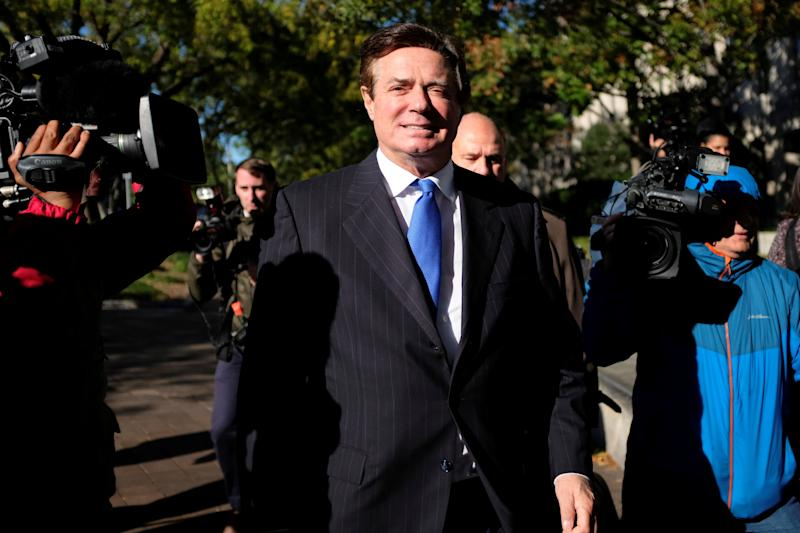 Paul Manafort, the former chairman of Donald Trump's presidential campaign, leaves the federal courthouse in Washington after being arraigned on 12 charges on Oct. 30, 2017.