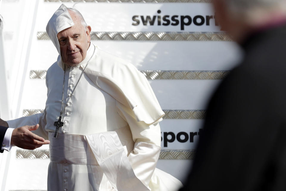A gust of win blows Pope Francis' cape as he arrives at Dublin international airport , Ireland, Saturday, Aug. 25, 2018. Pope Francis is on a two-day visit to Ireland. (AP Photo/Greorio Borgia)