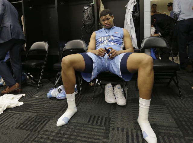 North Carolina's Kennedy Meeks sits in the locker room after the tam's loss to Iowa State in a third-round game in the NCAA college basketball tournament Sunday, March 23, 2014, in San Antonio. Iowa State won 85-83. (AP Photo/Eric Gay)
