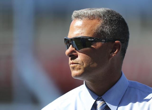 Dayton Moore general manager of the Kansas City Royals watches the team during batting practice before a baseball game against the Baltimore Orioles Wednesday, July 24, 2013, in Kansas City, Mo. (AP Photo/Ed Zurga)