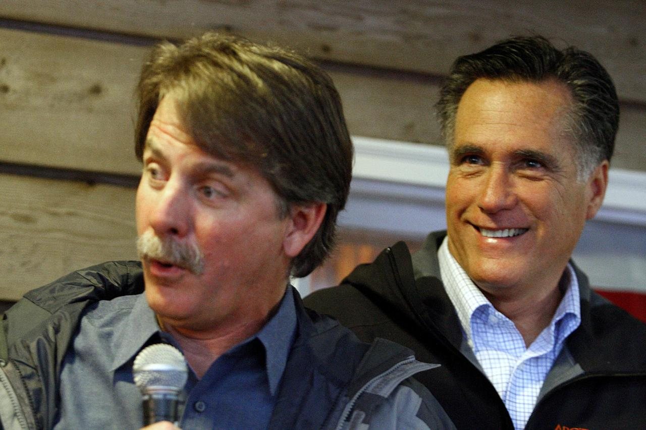 Comedian Jeff Foxworthy introduces Republican presidential candidate, former Massachusetts Gov. Mitt Romney at a campaign stop at the Whistle Stop Cafe, Monday, March 12, 2012, in Mobile, Ala. (AP Photo/ John David Mercer)