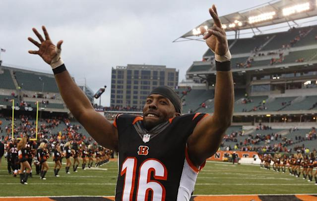 Cincinnati Bengals wide receiver Andrew Hawkins celebrates after the Bengals defeated the Baltimore Ravens 34-17 in an NFL football game on Sunday, Dec. 29, 2013, in Cincinnati. (AP Photo/David Kohl)