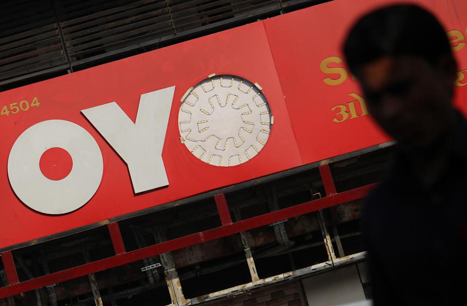 A man walks past a logo of Oyo Rooms on March 09, 2020 in Mumbai, India. (Photo by Himanshu Bhatt/NurPhoto via Getty Images)