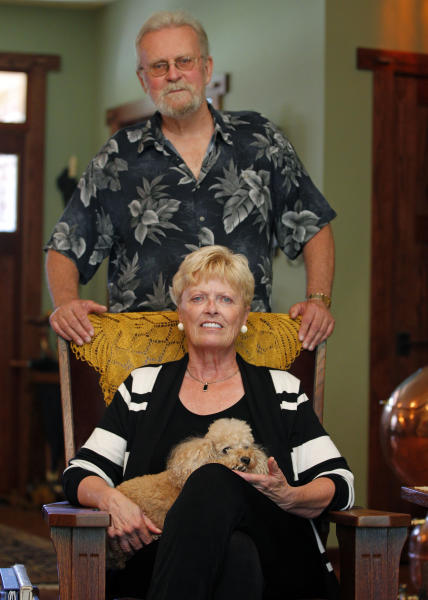In this photo taken Oct. 4, 2012, Carol Fentiman and her husband Jack pose in their home in Flat Rock, N.C. North Carolina's population has nearly doubled since 1970, fueled by an economic renaissance built around banking, health care, technology and widely regarded universities. The result is a presidential battleground. Transplants like Carol Fentiman, a 66-year-old retiree brought her Democratic politics with her, the kind of voter that helped make Barack Obama the first Democratic presidential nominee to win here since 1976. (AP Photo/Chuck Burton)