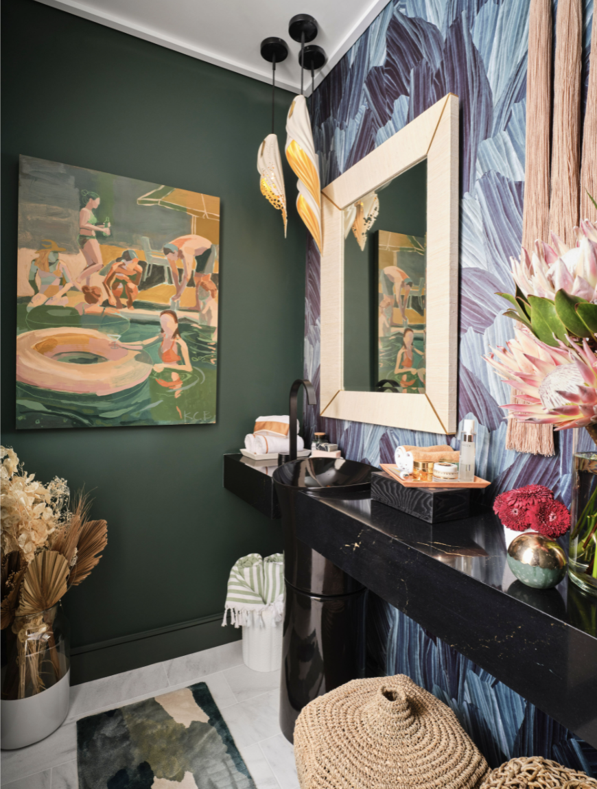 """<p>While the vanity room space was downsized, it's still a stunner. The space features commissioned artworks from Katherine Corden through Design Supply Shop and Lauren Williams Art, along with marble flooring by <a href=""""https://www.materials-marketing.com/"""" rel=""""nofollow noopener"""" target=""""_blank"""" data-ylk=""""slk:Materials Marketing"""" class=""""link rapid-noclick-resp"""">Materials Marketing</a>. Filled with body oils and face creams, masks, and serums by <a href=""""https://go.redirectingat.com?id=74968X1596630&url=https%3A%2F%2Fchantecaille.com%2F&sref=https%3A%2F%2Fwww.veranda.com%2Fdecorating-ideas%2Fhouse-tours%2Fg37664918%2Fkips-bay-dallas-show-house-tour-2021%2F"""" rel=""""nofollow noopener"""" target=""""_blank"""" data-ylk=""""slk:Chantecaille"""" class=""""link rapid-noclick-resp"""">Chantecaille</a> and luxe bath linens from <a href=""""https://usa.yvesdelorme.com/"""" rel=""""nofollow noopener"""" target=""""_blank"""" data-ylk=""""slk:Yves Delorme"""" class=""""link rapid-noclick-resp"""">Yves Delorme</a>, it's the perfect spot to steal away from the sun and prep your skin before going back out for another few hours in the Dallas heat.</p>"""