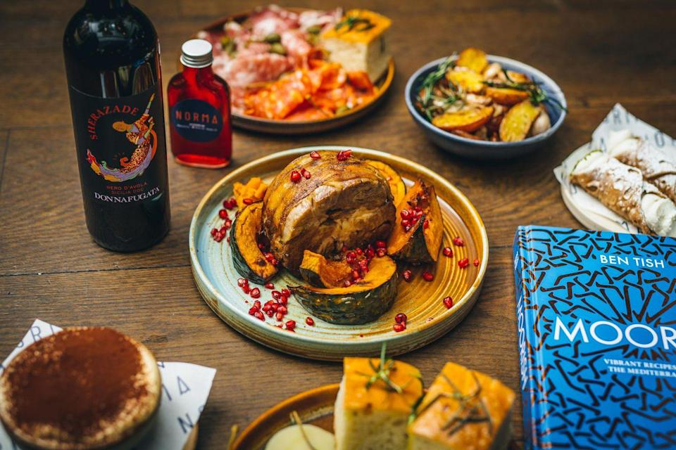 "<p>London's much-loved Sicilian hotspot Norma has found a way to bring the flavours of the restaurant straight to your home. Its head chef Ben Tish has been busy creating boxes full of nearly-finished plates of Sicilian classics, including fennel salumi, homemade focaccia and Norma's signature aubergine parmigiana with parmesan sauce. Also not to be missed are the tiramisu and homemade limoncello. </p><p><a href=""https://normalondon.com/"" rel=""nofollow noopener"" target=""_blank"" data-ylk=""slk:Norma London"" class=""link rapid-noclick-resp"">Norma London</a>, UK-wide delivery every Saturday, from £35.<br></p>"
