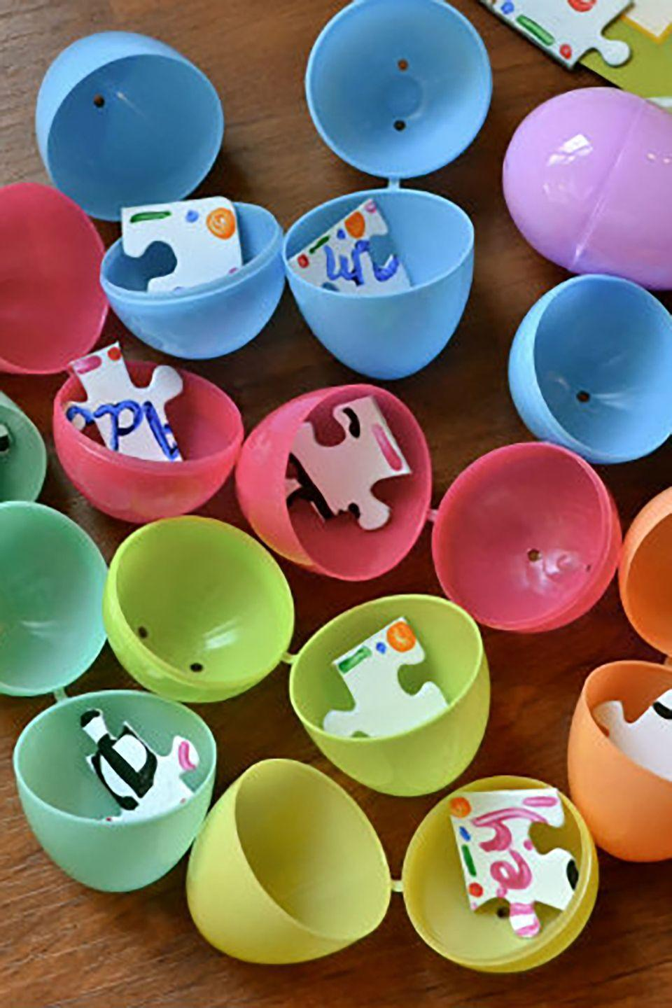 """<p>With a set of blank puzzle pieces, create your own design or message for your kids to piece together after the big hunt.</p><p><strong>Get the tutorial at <a href=""""http://makethebestofeverything.com/2013/02/puzzle-easter-egg-hunt.html"""" rel=""""nofollow noopener"""" target=""""_blank"""" data-ylk=""""slk:Make The Best Of Everything"""" class=""""link rapid-noclick-resp"""">Make The Best Of Everything</a>.</strong></p><p><strong><a class=""""link rapid-noclick-resp"""" href=""""https://www.amazon.com/Pack-Easter-Hinged-Fillable-Polly/dp/B07NWYY5KY/ref=sr_1_8?dchild=1&keywords=easter+eggs&qid=1614113230&sr=8-8&tag=syn-yahoo-20&ascsubtag=%5Bartid%7C10050.g.4083%5Bsrc%7Cyahoo-us"""" rel=""""nofollow noopener"""" target=""""_blank"""" data-ylk=""""slk:SHOP EASTER EGGS"""">SHOP EASTER EGGS</a><br></strong></p>"""