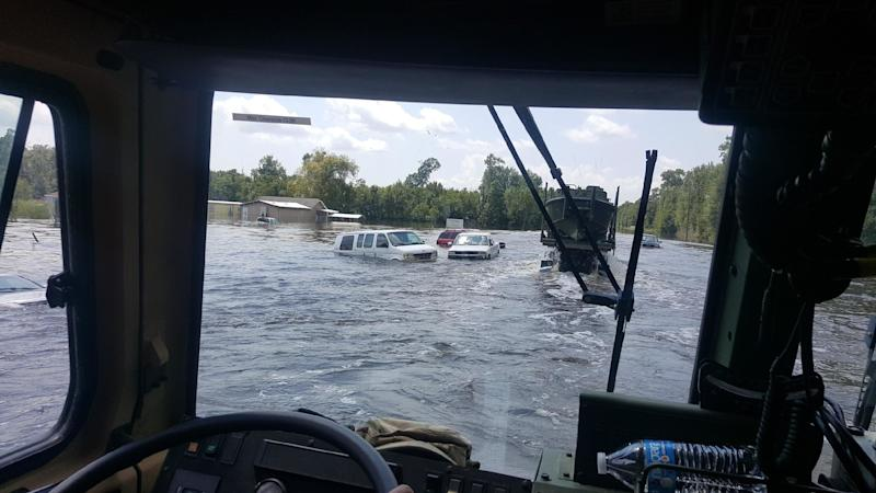 Floodwaters overtake vehicles in southeast Texas. (David Lohr/HuffPost)