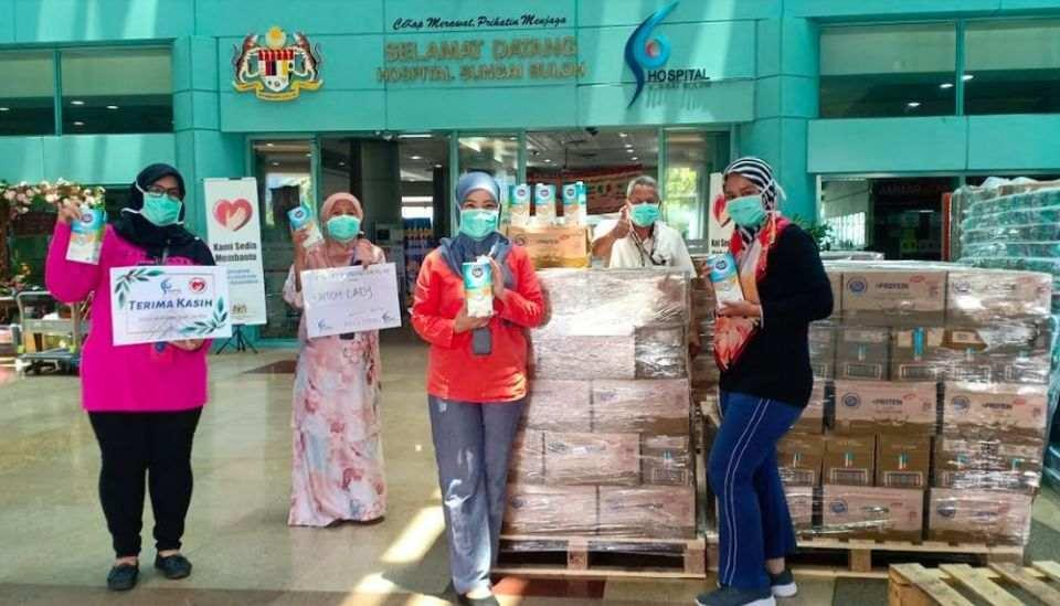 Dutch Lady Milk Industries Berhad delivers packs of Dutch Lady milk to medical frontliners at Sungai Buloh Hospital. — Picture courtesy of Dutch Lady Milk Industries Berhad