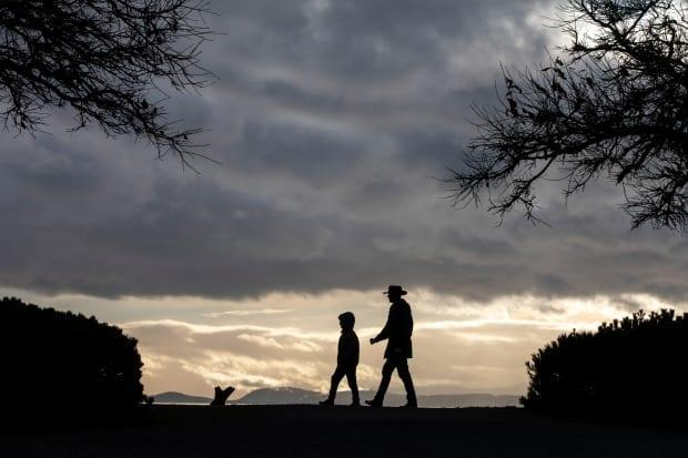 People are pictured walking at Garry Point Park in Richmond, B.C.