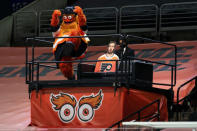 Philadelphia Flyers mascot Gritty reacts from his perch to a Flyers goal during the first period of the team's NHL hockey game against the Pittsburgh Penguins, Wednesday, Jan. 13, 2021, in Philadelphia. (AP Photo/Chris Szagola)