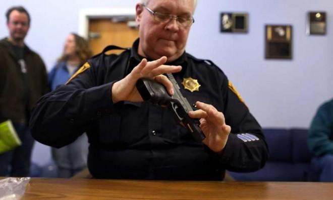 Lt. Ray Mesek registers a pistol at a gun buyback event at the Bridgeport Police Department in Connecticut on Dec. 22.