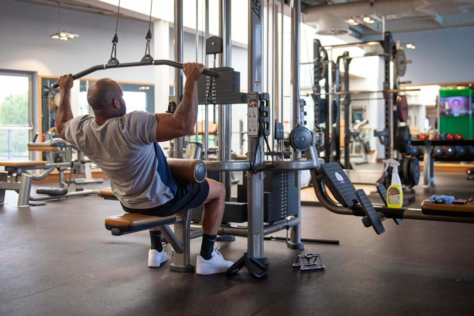 A gym member works out at David Lloyd in Cambridge: PA